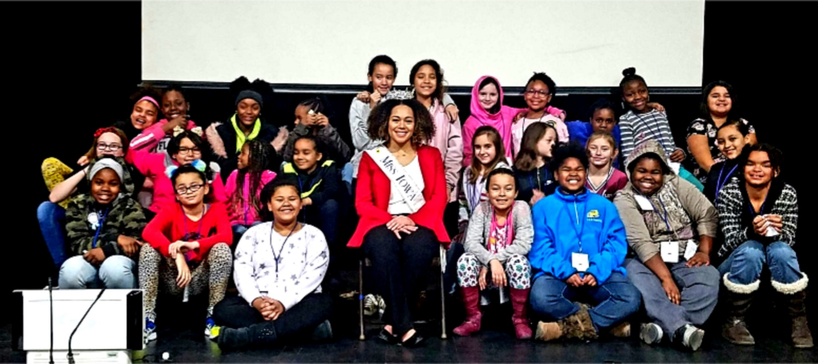 Miss Iowa 2018 posing with students at Madison Elementary School in Davenport, Iowa